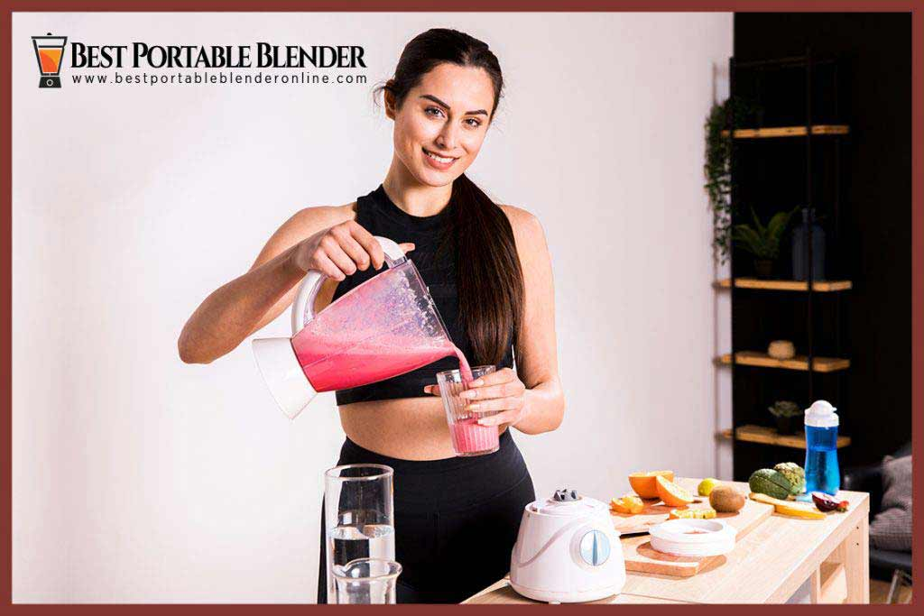Best Portable Blender Online - Girl holding a juicer blender