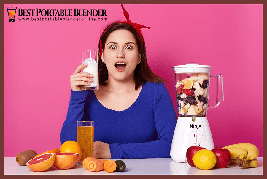 Girl drinking fruit smoothie prepared with Ninja Portable Blender