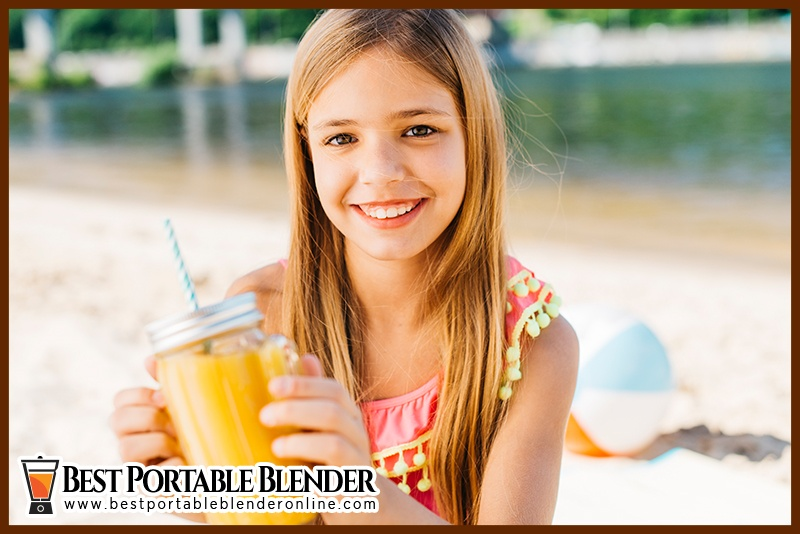 Girl enjoying her fruit juice while traveling to the beach