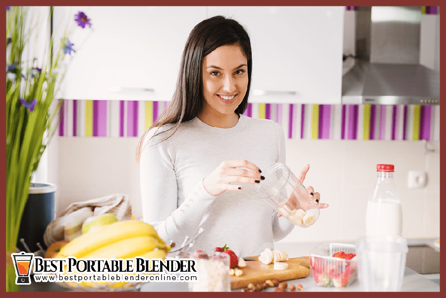Girl-preparing peanut-butter-banana smoothie-best-portable-blender-online