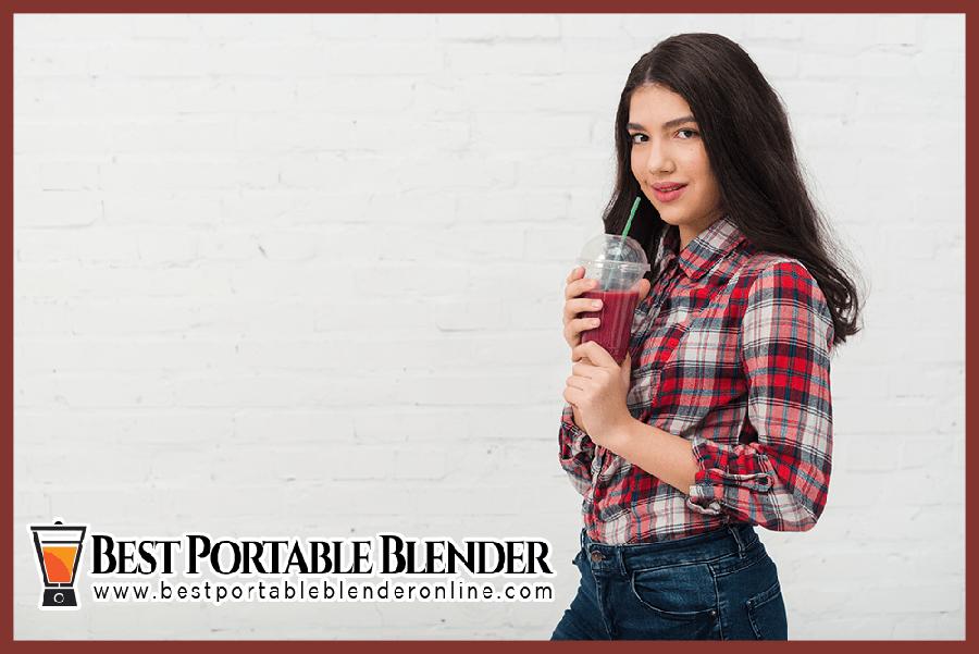black-hair-girl-enjoying-blueberry-banana-smoothie-best portable-blender-online
