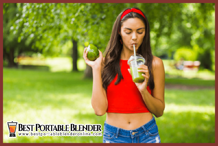 girl-in-red-top-drinking-green-smoothie-with-avocado-and-spinach