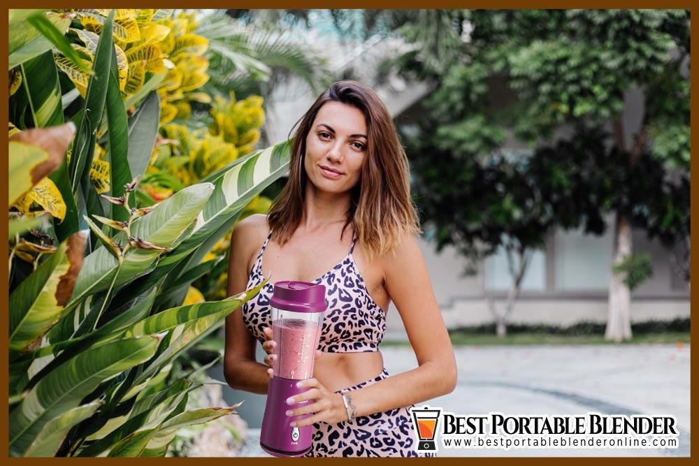 girl-holding-hamilton-beach-portable-blender-for-protein-shakes-in-garden