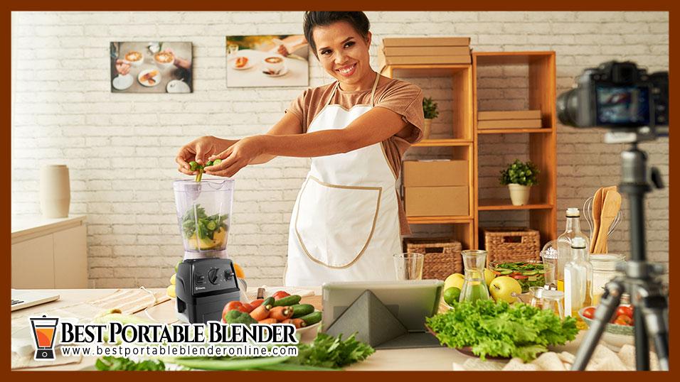 girl using vitamix blender to blend vegetables